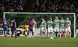 Xavi prepares to take a free kick as the Celtic wall lines up. Celtic v Barcelona, Uefa Champions League, Knockout phase, Celtic Park, Glasgow, Scotland. 20th February 2008.