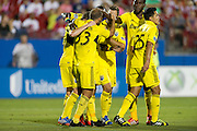 FRISCO, TX - SEPTEMBER 29:  Federico Higuain #33 of the Columbus Crew celebrates with teammates after scoring a goal against FC Dallas on September 29, 2013 at Toyota Stadium in Frisco, Texas.  (Photo by Cooper Neill/Getty Images) *** Local Caption *** Federico Higuain