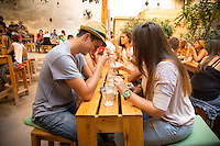 Athens, Greece- September 12, 2014: Friends share a laugh and freddo cappucinos at Six d.o.g.s., a multi-use artistic hub that features a spacious garden cafe and bar as well a space indoors for performances. CREDIT: Chris Carmichael for The New York Times