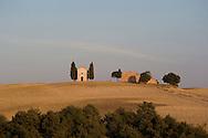 The Chapel Vitaleta and cypress trees in Val d'Orcia, Tuscany, Italy