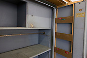 An open, empty safe, an exhibit in 'Haus 1' the ministerial headquarters of the Stasi secret police in Communist East Germany, the GDR. Built in 1960, the complex now known as the Stasi Museum. Before the fall of the Wall, it was a 22-hectare complex of espionage whose centrepiece is the office and working quarters of the former Minister of State Security, Erich Mielke who considered their role as the 'shield and sword of the party', conducting one of the world's most efficient spying operations against its political dissenters during its 40-year old socialist history. Between 1950 and 1989, the Stasi employed a total of 274,000 people in an effort to root out the class enemy. During Hitler's Third Reich, the Gestapo had one agent for every 2,000 citizens whereas the Stasi had approximately an spy for every 6.5. Here at the Stasi HQ alone 15,000 were employed plus the many regional stations. German media called East Germany 'the most perfected surveillance state of all time' - administered from this complex of offices.