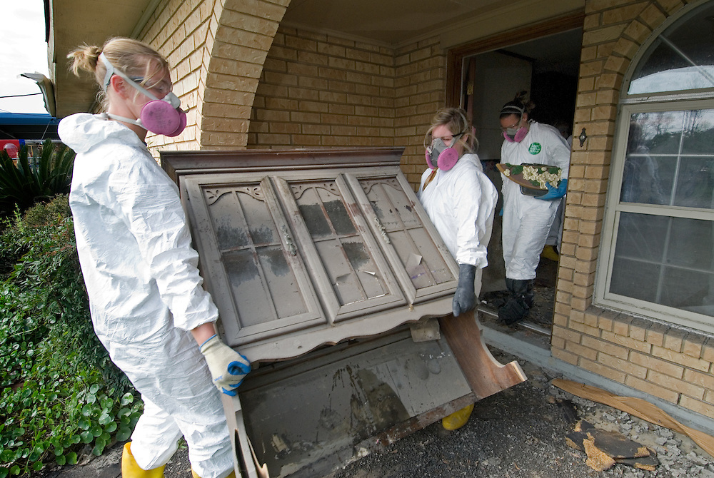 Volunteers in full protective gear strip heavily molded drywall and contents from Saint Bernard Parish homes.College students, faculty and staff members from Gettysburg (PA) College volunteer a week of their spring break gutting flood ravaged homes in Saint Bernard Parrish near New Orleans.