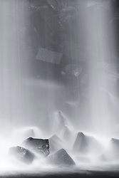 A close up from the Svartifoss pouring down on the rocks below in Iceland.