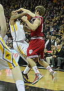 December 31 2012: Iowa Hawkeyes guard/forward Roy Devyn Marble (4) is fouled by Indiana Hoosiers guard Jordan Hulls (1) as he tries to put up a shot during the first half of the NCAA basketball game between the Indiana Hoosiers and the Iowa Hawkeyes at Carver-Hawkeye Arena in Iowa City, Iowa on Monday December 31, 2012. Indiana defeated Iowa 69-65.