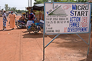 A group of women chat outside the offices of Micro Start in Ouagadougou, Burkina Faso. Micro Start is a project that helps organise credit and loans for women to start up their own small businesses.