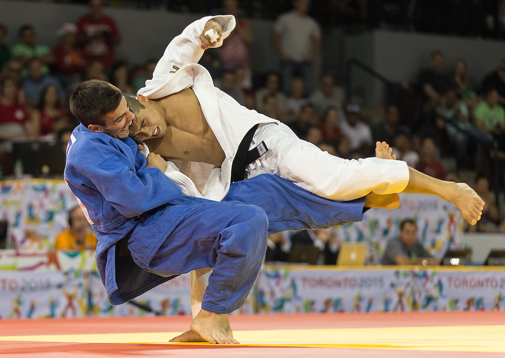 Antoine Bouchard of Canada (L) tries to take down Charles Chibana of Brazil in the Gold medal contest in the men's judo 66kg class at the 2015 Pan American Games in Toronto, Canada, July 12,  2015.  Chibana went on to defeat Bouchard to take the gold medal. AFP PHOTO/GEOFF ROBINS
