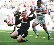 Picture by David Horn/Focus Images Ltd +44 7545 970036.29/09/2012.Charlie Macdonald of Milton Keynes Dons and Mark Ellis of Crewe Alexandra during the npower League 1 match at stadium:mk, Milton Keynes.
