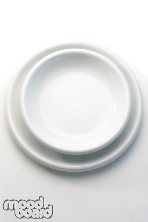 Close-up of white empty plates