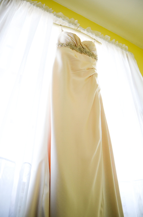Kathleen's pale gold sheath dress
