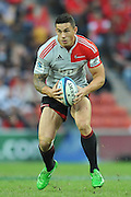 Sonny Bill Williams does a hope while running at the defence ~ Super 15 rugby (Round 15) - Reds v Crusaders played at Suncorp Stadium, Brisbane, Australia on Sunday 29th May 2011 ~ Photo : Steven Hight (AURA Images) / Photosport