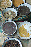 Peppercorns, fenugreek, mustard at Khari Baoli Spice and Dried Foods Market in Old Delhi, India