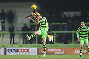 Cambridge United's Barry Corr(23) beats Forest Green Rovers Lee Collins(5) in the air during the EFL Sky Bet League 2 match between Forest Green Rovers and Cambridge United at the New Lawn, Forest Green, United Kingdom on 20 January 2018. Photo by Shane Healey.