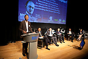 """Ari Kahn, New York City Mayors Office, moderates the panel """"Where Are You Joe Schumpeter? A Discussion on Electric Vehicles"""" at Manhattan Chamber of Commerce's Transportation Transformation Global Summit at NYIT in New York on April 26, 2012."""