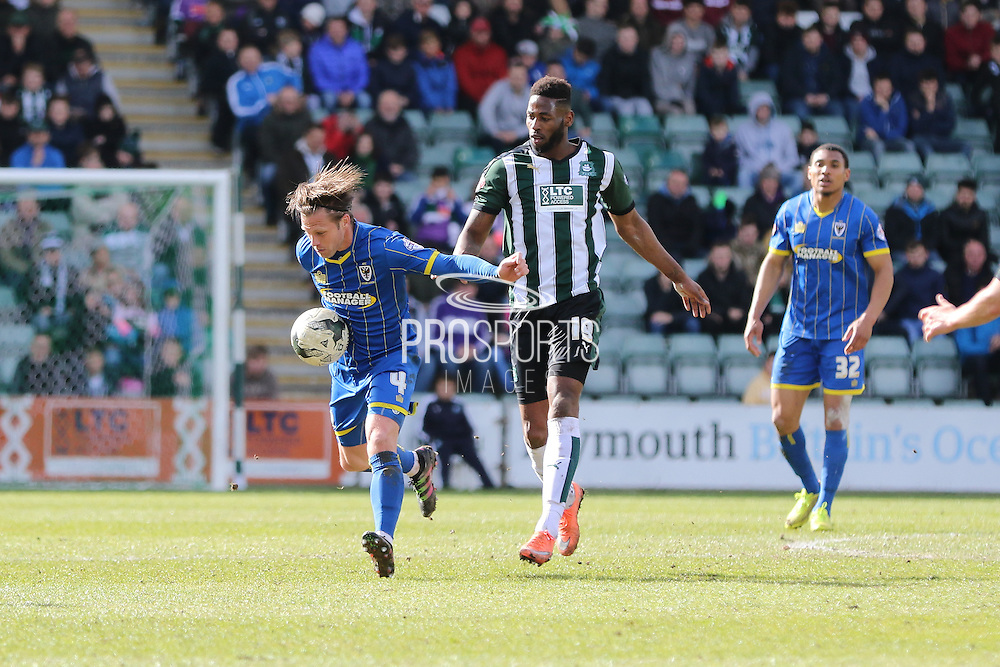 Dannie Bulman midfielder of AFC Wimbledon (4) gets ahead of Plymouth Argyle defender Jamille Matt  (19) during the Sky Bet League 2 match between Plymouth Argyle and AFC Wimbledon at Home Park, Plymouth, England on 9 April 2016. Photo by Stuart Butcher.