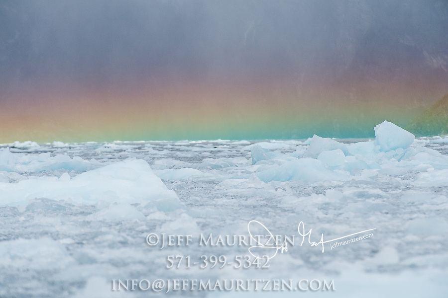 Rainbow over glacial ice in the Garibaldi fjord in Parque Nacional Alberto de Agostini, Chile.
