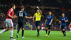 MANCHESTER, ENGLAND - Tuesday, August 18, 2015: Club Brugge's Brandon Mechele is shown his second yellow card, followed by a red, by referee Deniz Aytekin and is sent off during the UEFA Champions League Play-Off Round 1st Leg match against Manchester United at Old Trafford. (Pic by David Rawcliffe/Propaganda)