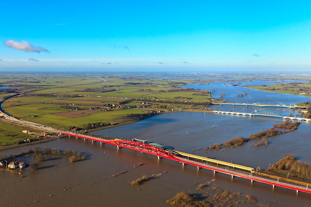 Nederland, Gelderland, Hattem, 20-01-2011; bruggen over IJssel bij hoogwater. De bruggen zijn: de rode spoorbrug van de Hanzelijn, de spoorbug van de bestaande spoorlijn, de IJsselbrug (boogbrug), de verkeersbrug voor de A28. Zwolle-Zuid in de achtergrond..Three (3) bridges on the river IJssel near Zwolle, land flooded by the high water of the river..luchtfoto (toeslag), aerial photo (additional fee required).copyright foto/photo Siebe Swart