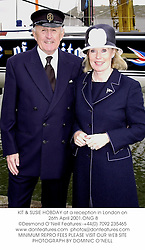 KIT & SUSIE HOBDAY at a reception in London on 26th April 2001.ONG 8