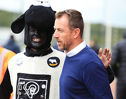 Derby County's manager Gary Rowett speaks to the fans as he makes his way into the ground prior to the Sky Bet Championship game against Bolton Wanderers.