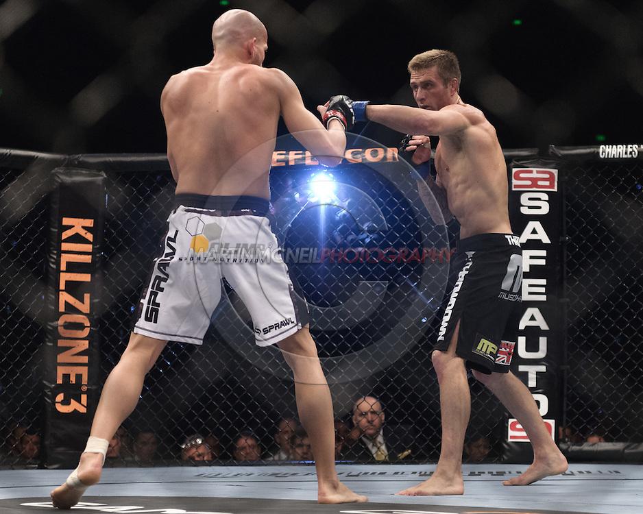 "SYDNEY, AUSTRALIA, FEBRUARY 27, 2011: Maciej Jewtuszko (left) tries to find his range against Curt Warburton during ""UFC 127: Penn vs. Fitch"" inside Acer Arena in Sydney, Australia on February 27, 2011."