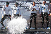 Oracle Racing helmsman James Spithill fumbles the champagne as he celebrates his winning the Match Racing 2-0 against Emirates Team New Zealand. Day six of the America's Cup World Series, Cascais, Portugal. 13/8/2011