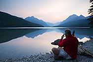 Photographer, Sunrise, reflection, Bowman Lake, Glacier National Park