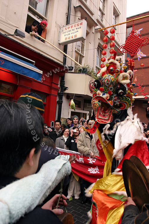 The traditional Chinese Dragon Dance during the Chinese New Year parade in Soho, London, UK, on Sunday, Feb. 13, 2005. As a wish of good auspices for the year to come Dragons visit the business around the area.  **ITALY OUT**