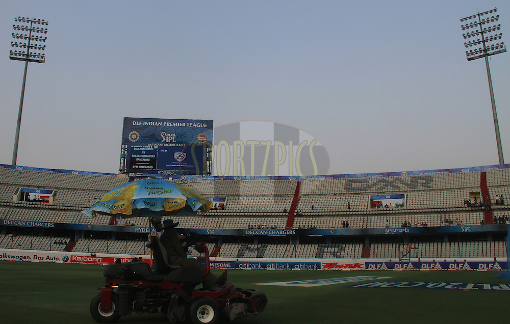 Grass mower takes a final round before commencement of  match 11 of the Indian Premier League ( IPL ) between the Deccan Chargers and the Royal Challengers Bangalore held at the Rajiv Gandhi International Cricket Stadium in Hyderabad on the 14th April 2011..Photo by Prashant Bhoot/BCCI/SPORTZPICS.