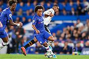 Chelsea midfielder Willan (10) turns around Valencia CF midfielder Geoffrey Kondogbia (6) during the Champions League match between Chelsea and Valencia CF at Stamford Bridge, London, England on 17 September 2019.