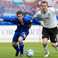 St Johnstone v Burnley...08.08.09 <br /> Kevin Moon battles with Kevin McDonald<br /> Picture by Graeme Hart.<br /> Copyright Perthshire Picture Agency<br /> Tel: 01738 623350  Mobile: 07990 594431