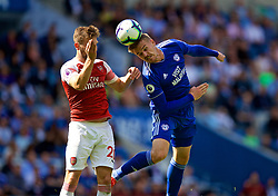 CARDIFF, WALES - Sunday, September 2, 2018: Cardiff City's Danny Ward (right) and Arsenal's Shkodran Mustafi during the FA Premier League match between Cardiff City FC and Arsenal FC at the Cardiff City Stadium. (Pic by David Rawcliffe/Propaganda)
