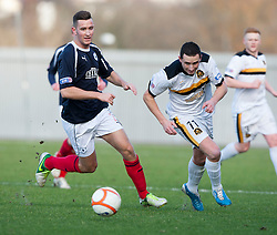 Falkirk's Kieran Duffie and Dumbarton's Nicky Phinn..half time : Dumbarton v Falkirk, 23/2/2013..©Michael Schofield.