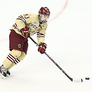 Johnny Gaudreau #13 of the Boston College Eagles controls the puck during The Beanpot Championship Game at TD Garden on February 10, 2014 in Boston, Massachusetts. (Photo by Elan Kawesch)