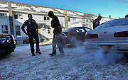 Bennington, VT -  Thursday, Jan. 30, 2014:   Patrolman Larry Cole, left, stands with a suspect as patrolman James Gulley, right, goes through the suspect's car after small amount of marijuana was found during a routine stop on Benmont Ave. No arrest or citation was made.<br /> <br /> Gov. Peter Shumlin devoted his entire state of the state address in January to what he called a &quot;full-blown heroin crisis&quot; in Vermont, where twice as many people died of heroin overdoses in 2012 as in the year before. Mr. Shumlin's address focused new attention on the problem, which has hit every corner of the state.<br /> <br /> CREDIT: Cheryl Senter for The New York Times Heroin in Vermont