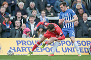 Jamie Devitt (Carlisle United) and Carl Magnay (Hartlepool United) tangle on the sideline with Jamie Devitt (Carlisle United) going down for a free kick during the EFL Sky Bet League 2 match between Hartlepool United and Carlisle United at Victoria Park, Hartlepool, England on 14 April 2017. Photo by Mark P Doherty.