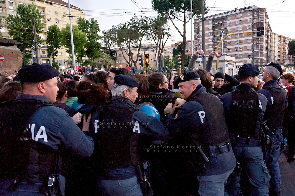 The police pushes women who at the end of the march have occupied Largo Preneste.<br /> Demostration of women in Prenestino district, against gender violence and against political exploitation of the rape  which occurred a few days ago in Via Teano on May 20, 2016 in Rome, Italy.