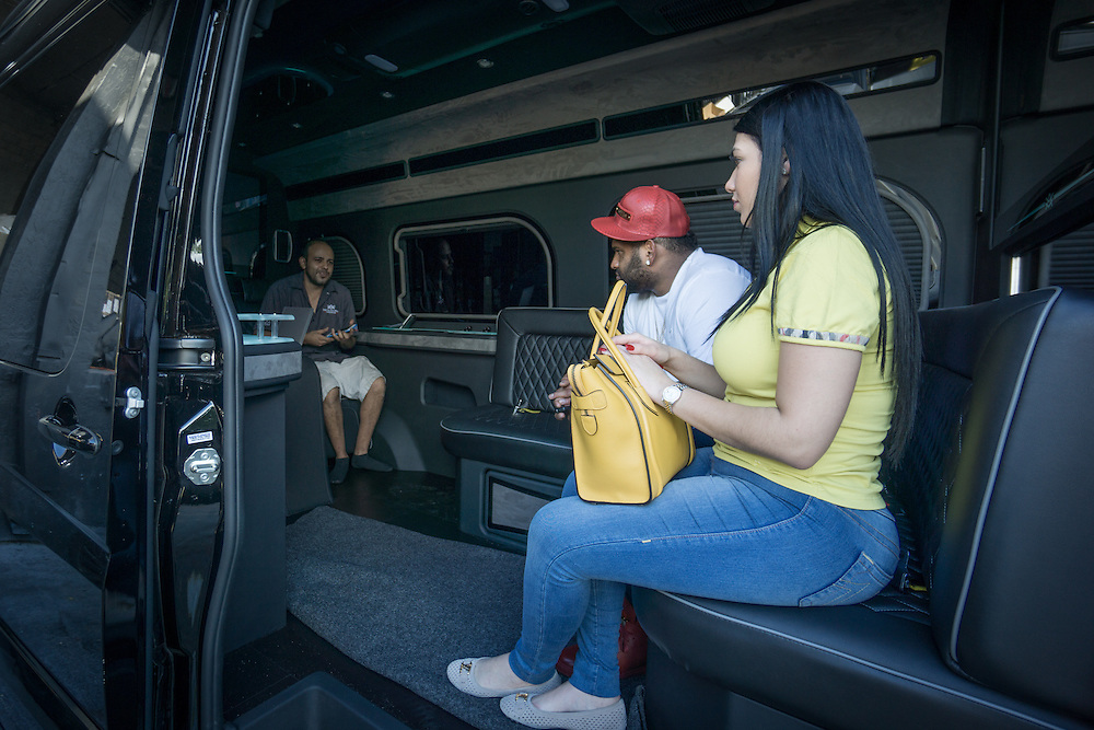 DORAL, FLORIDA, DECEMBER 11, 2015<br /> Alberto Faraldo, left, of The Auto Firm, a South Florida car customizing and restoring shop which has a vast clientele of professional athletes and entertainers,  shows Pablo Sandoval and wife Yulimar Martins a customized Mercedes Benz limo van. The van sells for $175.000.<br /> (Photo by Angel Valentin/Freelance)