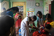 A health worker, centre, immunises a child at an Aanganwadi, a government family health centre in Rangsaipet, in Waragal, Telangana, Indiia, on Saturday, February 9, 2019. Photographer: Suzanne Lee for Safe Water Network
