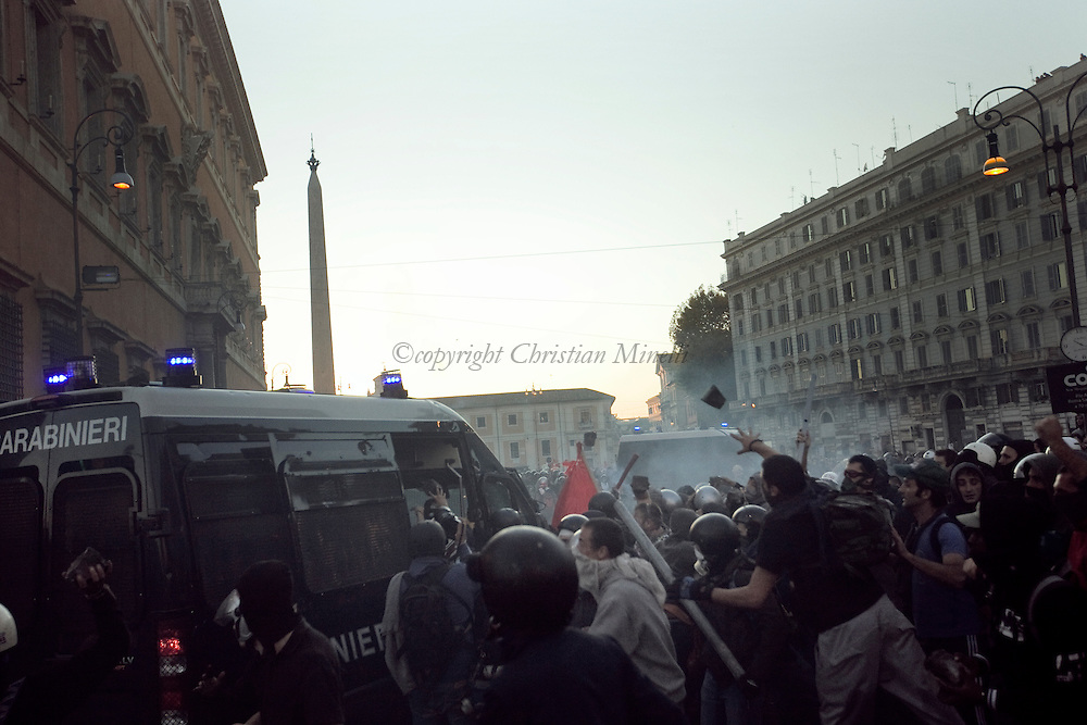 ITALY, Rome,October 15, 2011 : Protesters attack a Police van during a demonstration in Rome on October 15, 2011. © Christian Minelli/Emblema.