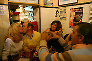 "A couple kisses at ""Tasca do Chico"", one of the typical spots were to see live perfomances of Fado music and were the audience can spontaneously participate and also ask to sing. It is located in  Bairro Alto neighborhood."