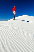 Hiker and gypsum dune patterns, White Sands National Monument, New Mexico USA