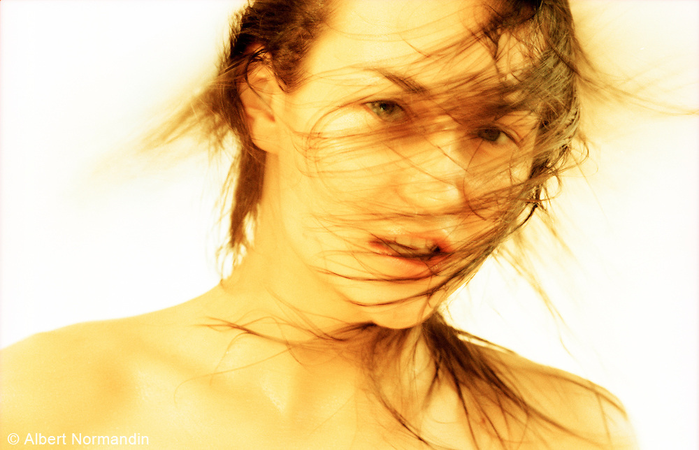 Woman hair and face blurred, yellow