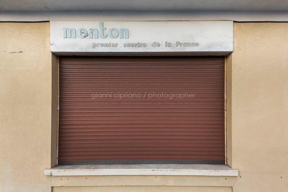 MENTON, FRANCE - 18 NOVEMBER 2014: A tourist office for the promotion of the  city of Menton closed when the Schengen area was established, in Menton, France, on November 18th 2014.
