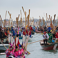 VENICE, ITALY - FEBRUARY 16:  Rowers lift their oars in sign of salute ahead of the  traditional regatta on the Grand Canal which officially opens the Venice  Carnival  on February 16, 2014 in Venice, Italy. The 2014 Carnival of Venice will run from February 15 to March 4 and includes a program of gala dinners, parades, dances, masked balls and music events.  (Photo by Marco Secchi/Getty Images)