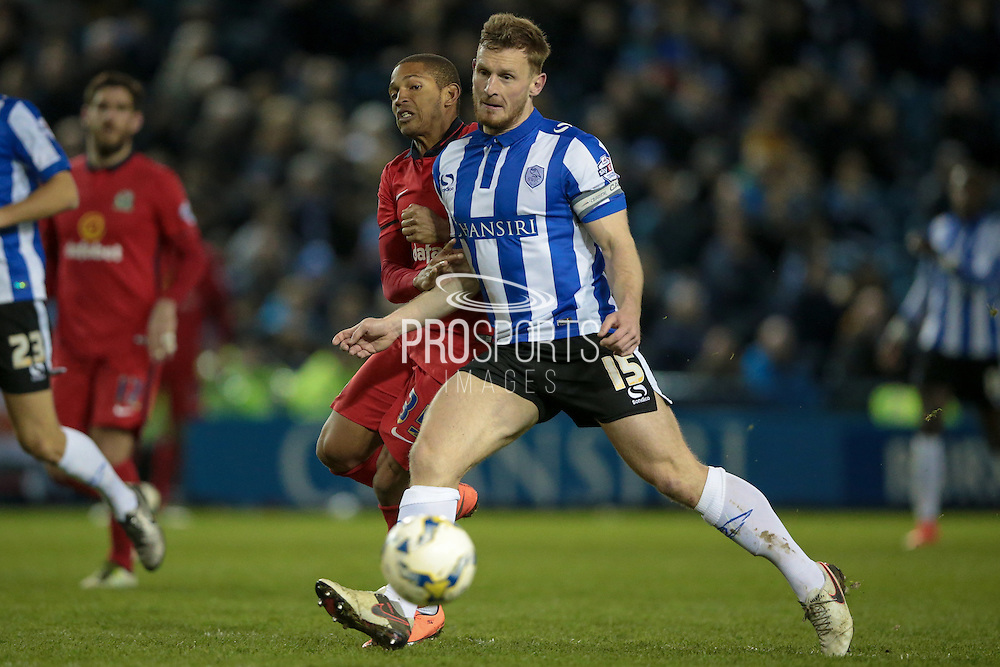 Tom Lees (c) (Sheffield Wednesday) holds off Simeon Jackson (Blackburn Rovers) to allow the ball to reach his keeper safely during the Sky Bet Championship match between Sheffield Wednesday and Blackburn Rovers at Hillsborough, Sheffield, England on 5 April 2016. Photo by Mark P Doherty.