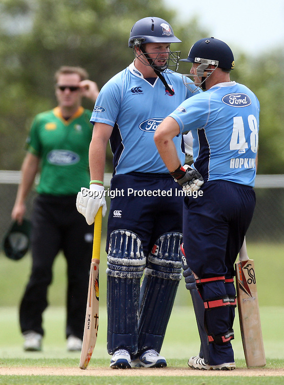 Colin Munro and Gareth Hopkins. Auckland Aces v Central Stags, One Day Cricket. Colin Maiden Park, Auckland, Wednesday 19 January 2011. Photo: Ella Brockelsby/photosport.co.nz