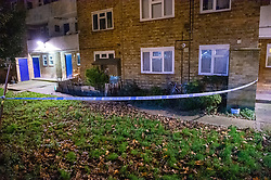© Licensed to London News Pictures. 09/12/2019. London, UK. Police tape marks a cordoned area at Shelley House on Boyton Road after a man was fatally stabbed. Metropolitan Police were called by the London Ambulance Service at 18:04GMT on Monday, 9 December to a residential address in Shelley House, Boyton Road N8, following reports of a fight and a man having been stabbed. A man, aged in his 40s, was found suffering from a stab injury. He was pronounced dead at the scene. Photo credit: Peter Manning/LNP