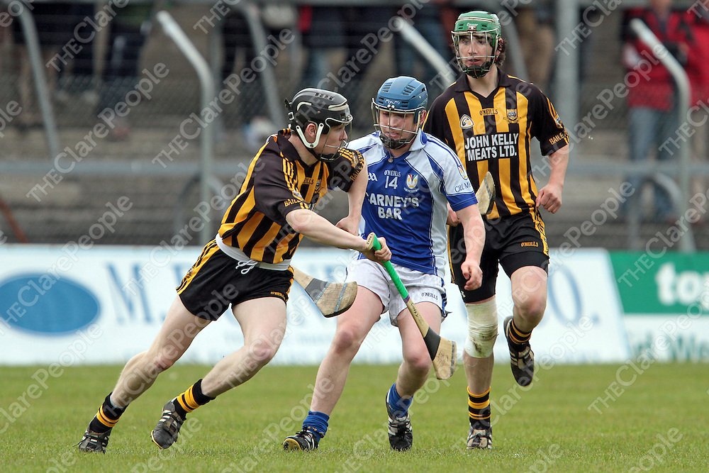 Tony Kelly Ballyea comes away with possession against Kilmaley's Michael O'Neill in their U21A Final replay at Cusack Park. - Photograph by Flann Howard