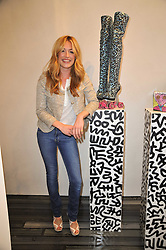 CAT DEELEY at the opening party for Nicholas Kirkwood's new store at 5 Mount Street, London on 12th May 2011.