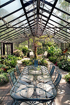 000426 ATLANTA,GA.: An old greenhouse has been converted to a dining/entertaining area at Home Depot's Arthur Blank's 4-acre garden. The garden is one of the gardens on the Connoisseurs Garden Tour. (JOEY IVANSCO/staff photo).
